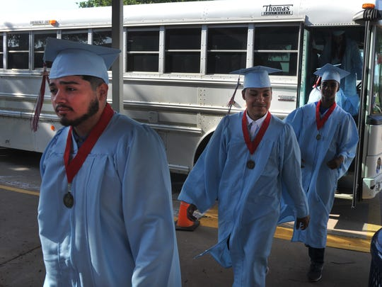 Soon-to-be high school graduates from Hirschi exit a school bus at Burgess Elementary on-their-way to encourage students to well in school.