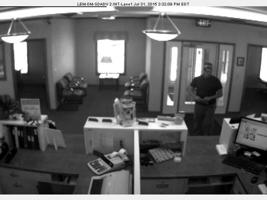 Police are looking for a man who they say robbed the Community Bank on East Main Street Friday afternoon.