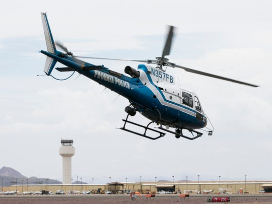 Phoenix Police helicopter pilot John Meche takes off from Deer Valley Airport. Pat Shannahan/ The Arizona Republic Byline:  Byline-Title: