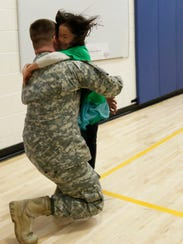 Kindergartener Bianca Withers runs to embrace her father,