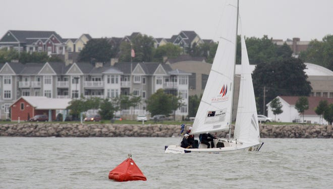 Australian sailors around a buoy during the International Association for Disabled Sailing championships Friday September 12, 2014 in Sheboygan.