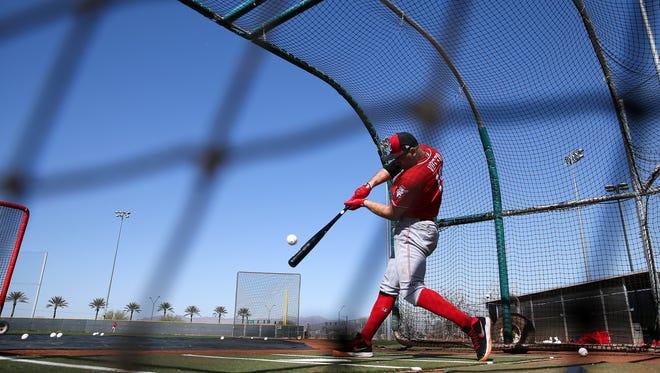 Cincinnati Reds first baseman Joey Votto (19) swings during batting practice, Tuesday, Feb. 20, 2018, at the Cincinnati Reds Spring Training facility in Goodyear, Arizona.