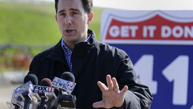 Gov. Scott Walker speaks about his proposed transportation budget Thursday at a U.S.10/State 441 construction site in Fox Crossing.