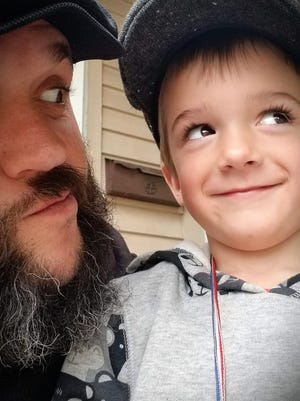 Recovering heroin addict Nathan Scheer of Fond du Lac and his son, Bentley, 4, have been working to clean up the city, as a way of giving back to the community.