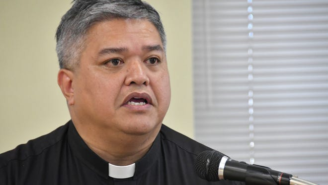 Father Jeffrey San Nicolas announces seven new members will join two incumbents on the newly reconstituted Archdiocesan Finance Council, at a press conference in Hagåtña on Oct. 6.