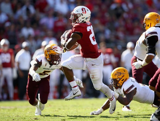 Bryce Love #20 of the Stanford Cardinal runs with the