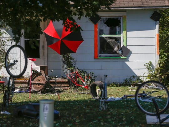 The windows broken out and a trampoline, bicycle parts,