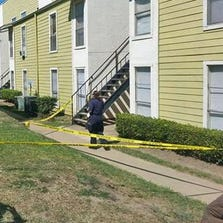Police secured the area of an apartment complex where a five-year-old girl was found dead on August 31, 2014.