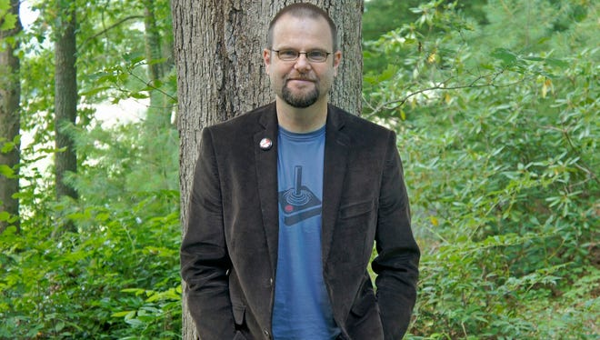 "Local author Alan Gratz introduced two new books this month: ""The Monster War"" and ""Projekt 1065."""