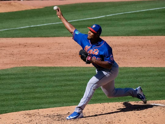Mar 3, 2018; Jupiter, FL, USA; New York Mets relief pitcher Jeurys Familia (27) delivers a pitch against the Miami Marlins at Roger Dean Stadium.