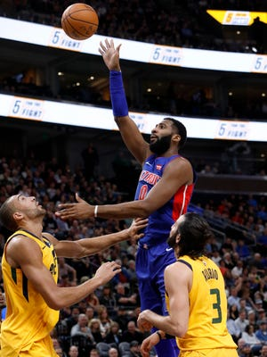 Pistons' Andre Drummond shoots over the Jazz's Rudy Gobert, left, and Ricky Rubio in the first half Tuesday, March 13, 2018 in Salt Lake City.