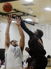 West Ranch's Suren Aghazadian, left, and Oxnard's James Carper go for a rebound during the Ventura Kiwanis Tournament championship game on Thursday night.