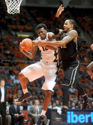 Illinois' Leron Black (12) pulls down a rebound against Purdue's Vince Edwards (12) during the second half of an NCAA college basketball game between Purdue and Illinois at State Farm Center  in Champaign, IL on Wednesday, Jan. 21, 2015. Illinois won 66-57. (AP Photo/Heather Coit)