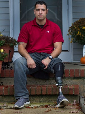 Former army medic Ruben Gomez who lost part of his leg and part of his hand and suffered a broken neck when he was struck by an artillery round while serving in Afghanistan in 2011. He now volunteers as an intermediary  in a court diversion program in Ocean County for eligible veterans accused of crimes into treatment. Photo taken at his Stafford Township home.