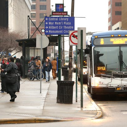 The IndyGo bus stop at Ohio and Pennsylvania Street is packed with riders in downtown Indianapolis on Thursday, Jan. 29, 2015.