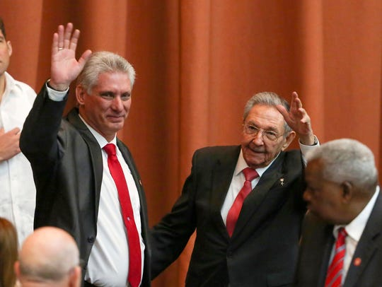 Cuba's new president Miguel Diaz-Canel, left, and former