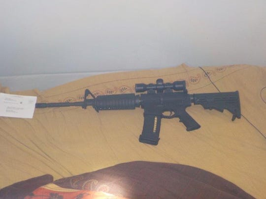 One of two loaded AR-15 .223 caliber rifles found in  in the 3500 block of Catalpa Avenue on Aug. 25, 2016, as IMPD officers served a search warrant at a home.