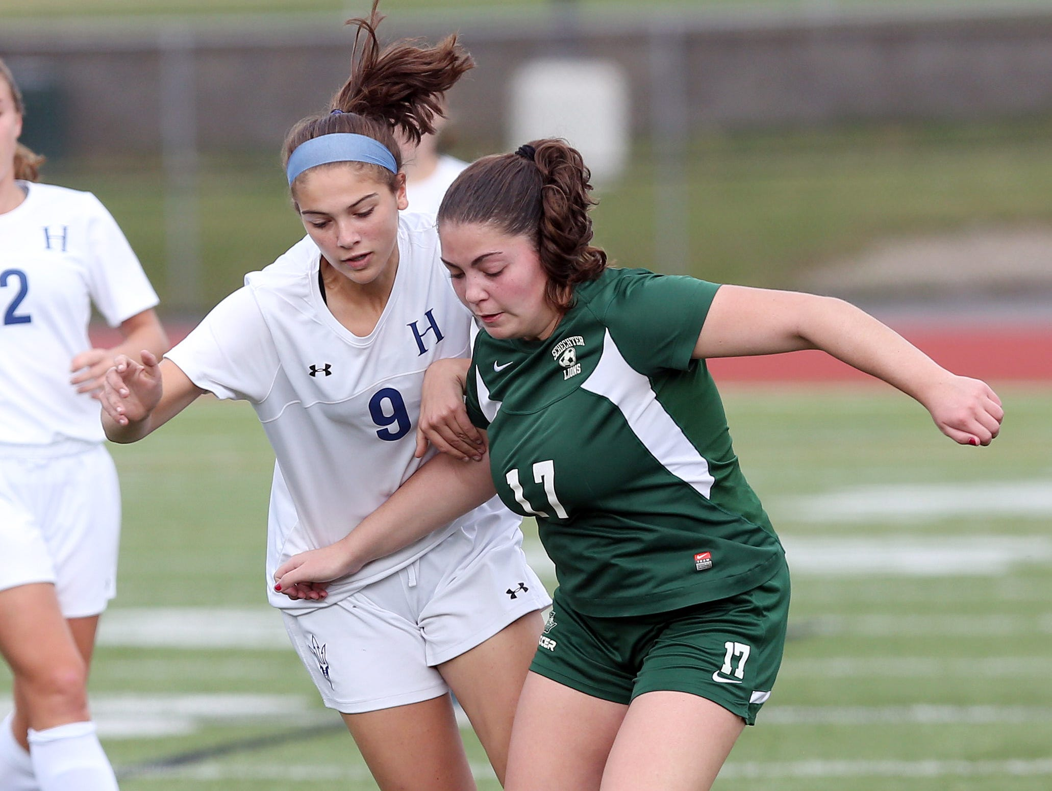 From left, Haldane's Evy Asburn (9) and Schechter's Alexa Cotel-Altman (17) battle for ball control during the girls soccer Section 1 Class C championship game at Yorktown High School Oct. 30, 2016. Haldane won the game 3-0.
