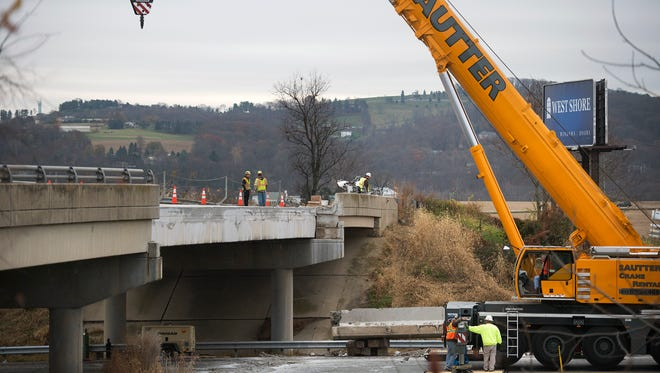 Repairs are made on the Route 30 overpass in eastern York County after it was struck by a backhoe and damaged.