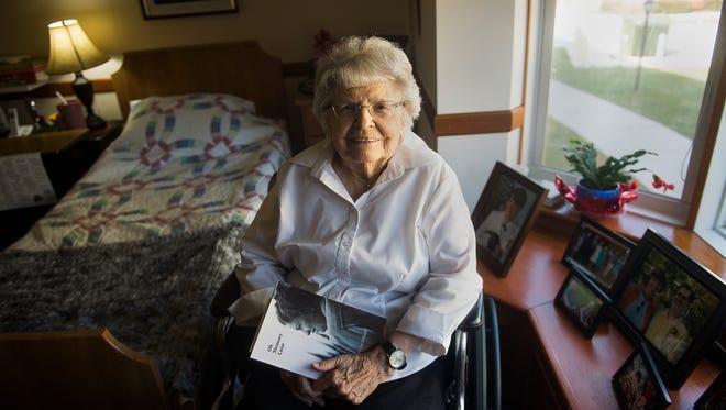 Cross Keys Village resident Irene Miller holds a book written by Helen Schmidt, her pen pal's sister, on March 3, 2016.