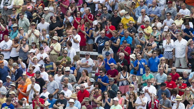 Fans begin to fill the grandstands during pre-race ceremonies of the 99th running of The Indianapolis 500, May 23, 2015, in Speedway, Ind.
