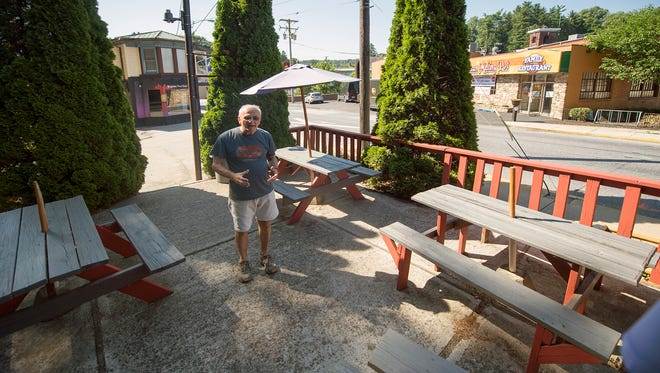 Owner Gene Montanarelli, who will open the Great American Melting Pot, right, on Monday, already has plans for a space across the street. He hopes to open an ice cream shop with some live music next year.