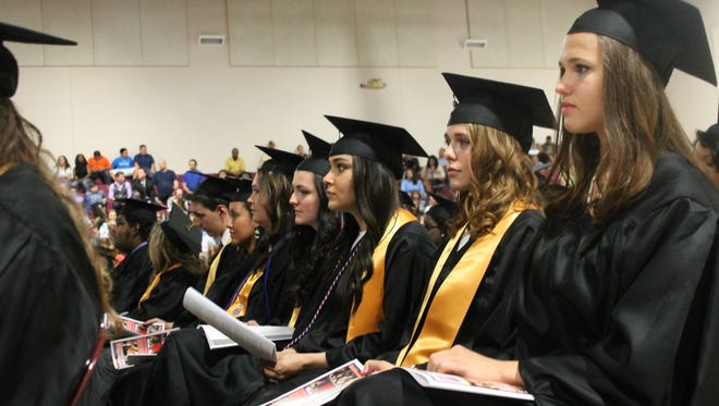 In this file photo graduates from NMSU-A's Class of 2015 listened to a speech during last year's commencement.