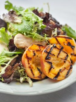 Chicken salad with grilled peaches.