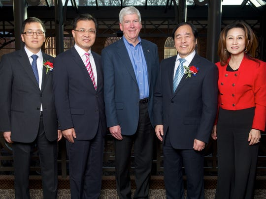From left, CW Bearing USA President and CEO John Hu, Consul General of Chinese Consulate in Chicago Zhao Weiping. Mich. Gov. Rick Snyder, Chairman of Cixing group Hu Xiangen and Executive Vice President of U.S.-China Automotive Exchange  Lisa Gray pose at a groundbreaking Monday in Northville.