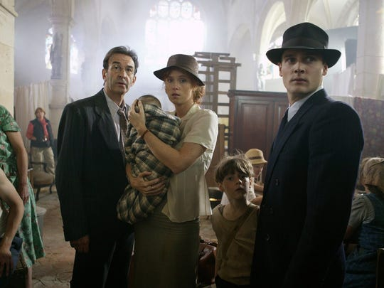 """The mayor of """"A French Village"""" finds himself deposed by the Nazi occupiers, and he and his wife (and an infant they've taken in) find themselves homeless."""