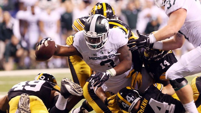 Michigan State Spartans running back LJ Scott dives in for the winning touchdown.