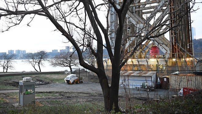 A security booth, at the bottom left of photo, sits at the foot of the George Washington Bridge on the New York side. Photographed in Fort Washington Park on Wednesday, December 14, 2016.