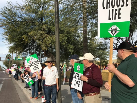 Protesters against Planned Parenthood rally outside