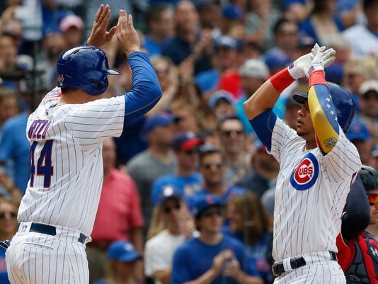Chicago Cubs' Wilson Contreras, right, celebrates with Anthony Rizzo after hitting a two-run home run during the sixth inning of a baseball game against the Washington Nationals, Saturday, Aug. 5, 2017, in Chicago. (AP Photo/Nam Y. Huh)