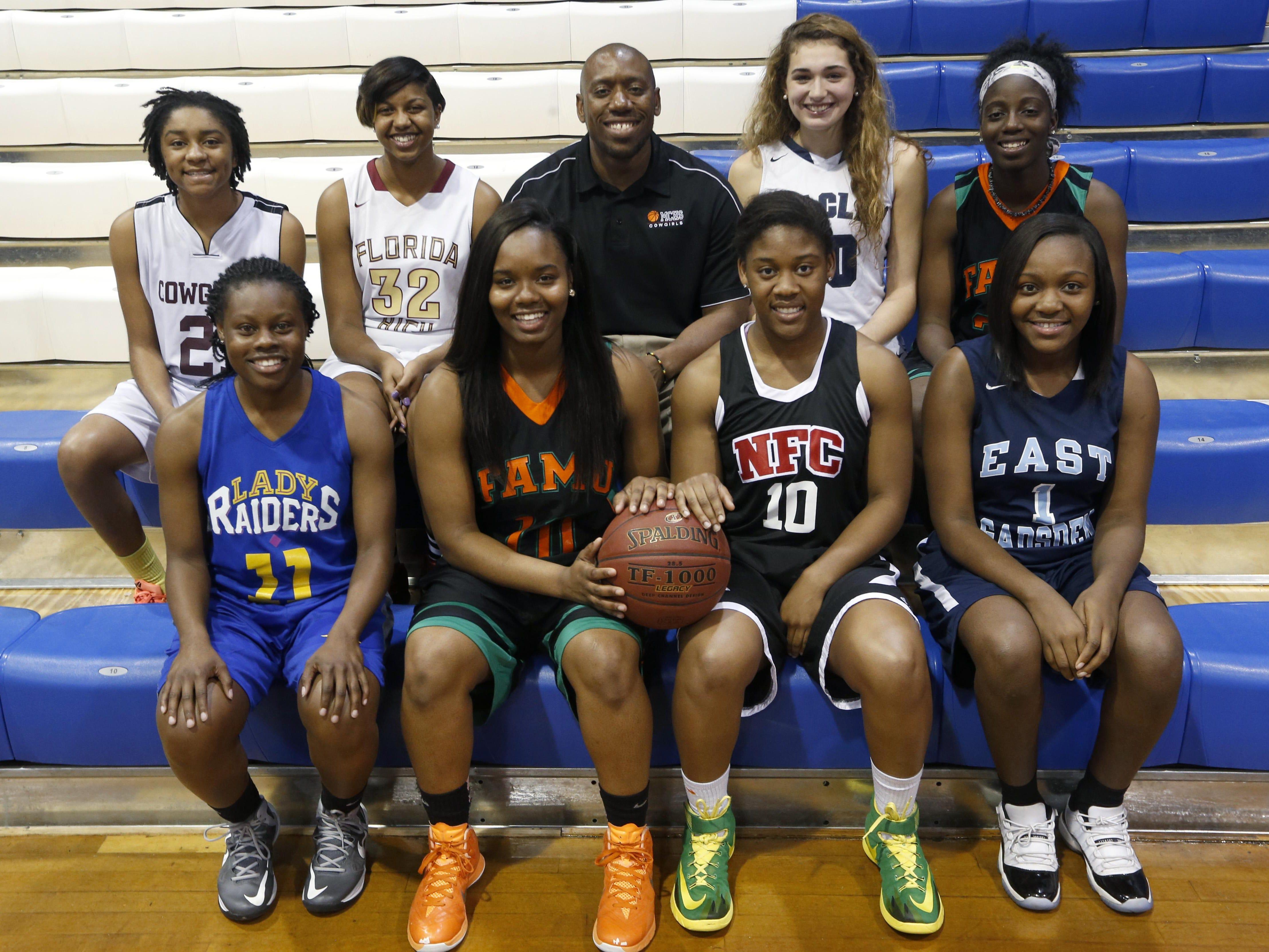 2014-15 All-Big Bend girls basketball first team. Front row, L-R: Jazmine Harris (Rickards), Ja'Nyia McNealy (FAMU DRS), Rosanna Jenije (NFC), Dondrea Harris (East Gadsden) Back row, from left: Jameica Cobb (Madison County), Shakeriah Carter (Florida High), Madison County coach Marcus Hawkins, Hannah Schuchts (Maclay), Jazmine Jones (FAMU DRS)