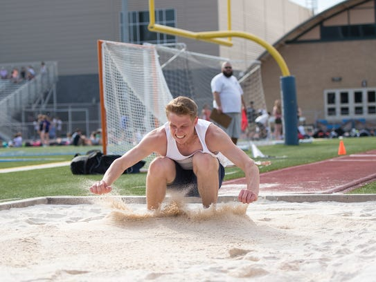 Chambersburg's Nate Reed competes in the long jump