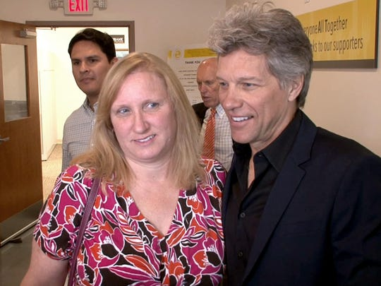Christina Donahue, Toms River, joins Jon Bon Jovi after the grand opening of the BEAT Center in Toms River, NJ, Tuesday, May 10, 2016. She was recognized during the opening ceremony as one of the people who will be benefited by its opening.