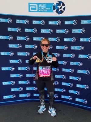 Wendy Garrett of Turner poses after completing the Tokyo Marathon on Feb. 25, 2018.