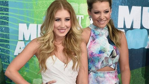 "Tae Dye, right, and Maddie Marlow of the musical group Maddie & Tae arrive at the CMT Music Awards in June in Nashville. Only three songs with female voices are in the current Top 25 of Billboard's Hot country songs chart with Little Big Town's ""Girl Crush,"" Cam's ""Burning House"" and Maddie & Tae's ""Fly."""