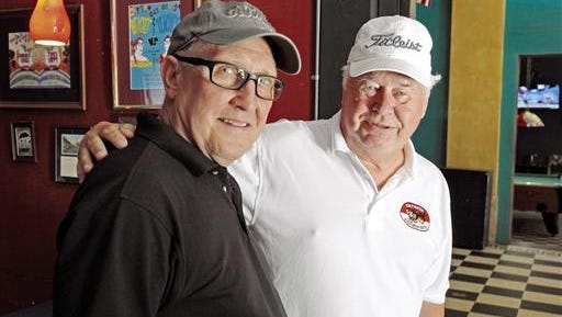 Chris Oelerich and Jim Nowicki stand in The Princess, a restaurant in downtown Columbus, Miss. The two Vietnam veterans recently completed a 3,000-mile road trip to see some of their old buddies.