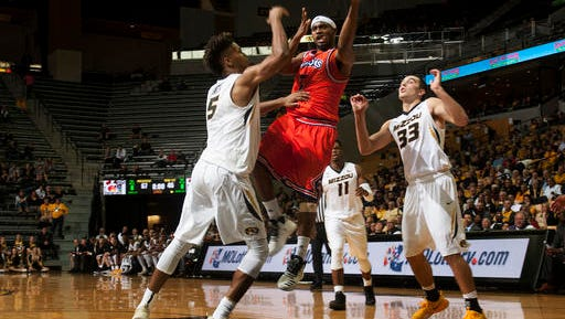 Northwestern State's Devonte Hall, center, passes the ball between Missouri's Mitchell Smith, left, Cullen VanLeer, right, and K.J. Walton (11) during the second half of an NCAA college basketball game Saturday, Nov. 26, 2016, in Columbia, Mo. Missouri won the game 84-60. (AP Photo/L.G. Patterson)