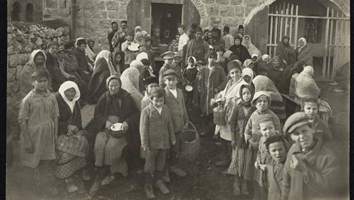 In this 1921 photo provided by the American Jewish Joint Distribution Committee (JDC), children and elderly men and women wait for food outside the JDC-supported Dreyfus soup kitchen in Jerusalem. The JDC, a 100-year-old humanitarian assistance organization that helps Jews and non-Jews around the world, is the focus of a New York City exhibition ?I Live. Send Help,? which will include the photo.