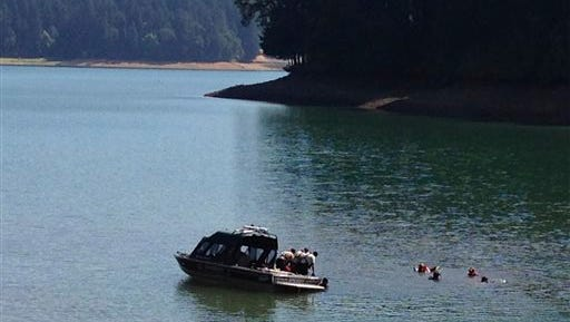 """Rescue personnel search Henry Hagg Lake, a reservoir in Gaston, Ore., west of Portland, today for family members of a child who apparently drowned Monday at the lake. """"Deputies fear there may be additional drowning victims,"""" the sheriff's office said in a press release."""