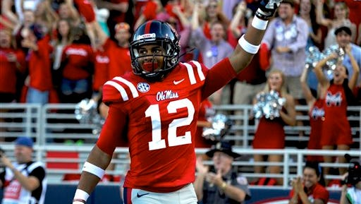 Mississippi wide receiver Donte Moncrief (12) points to the crowd after scoring on a 55-yard touchdown during the first quarter of an NCAA college football game in Oxford, Miss., Saturday, Sept. 8, 2012. (AP Photo/Austin McAfee)