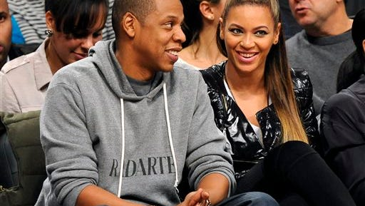 FILE - This Nov. 23, 2012 file photo shows entertainers Jay Z and his wife Beyonce at the Brooklyn Nets against the Los Angeles Clippers NBA basketball game at Barclays Center in New York.