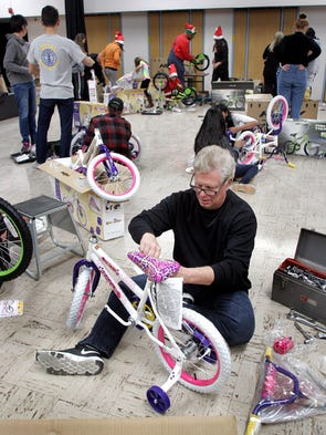 William Klepper puts a bike together during the Holiday