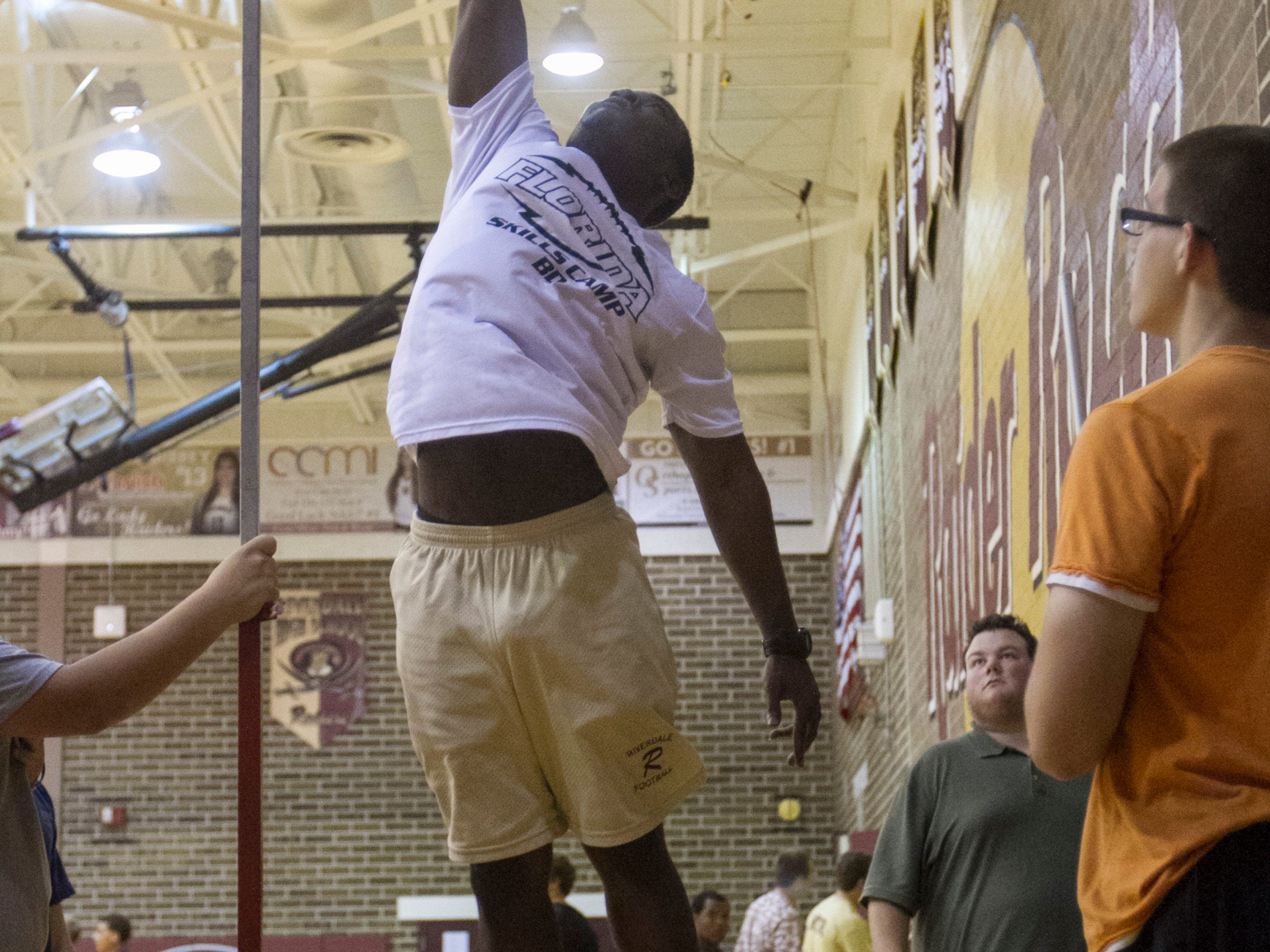 Andres Bartley tests his vertical leap at Riverdale High School.