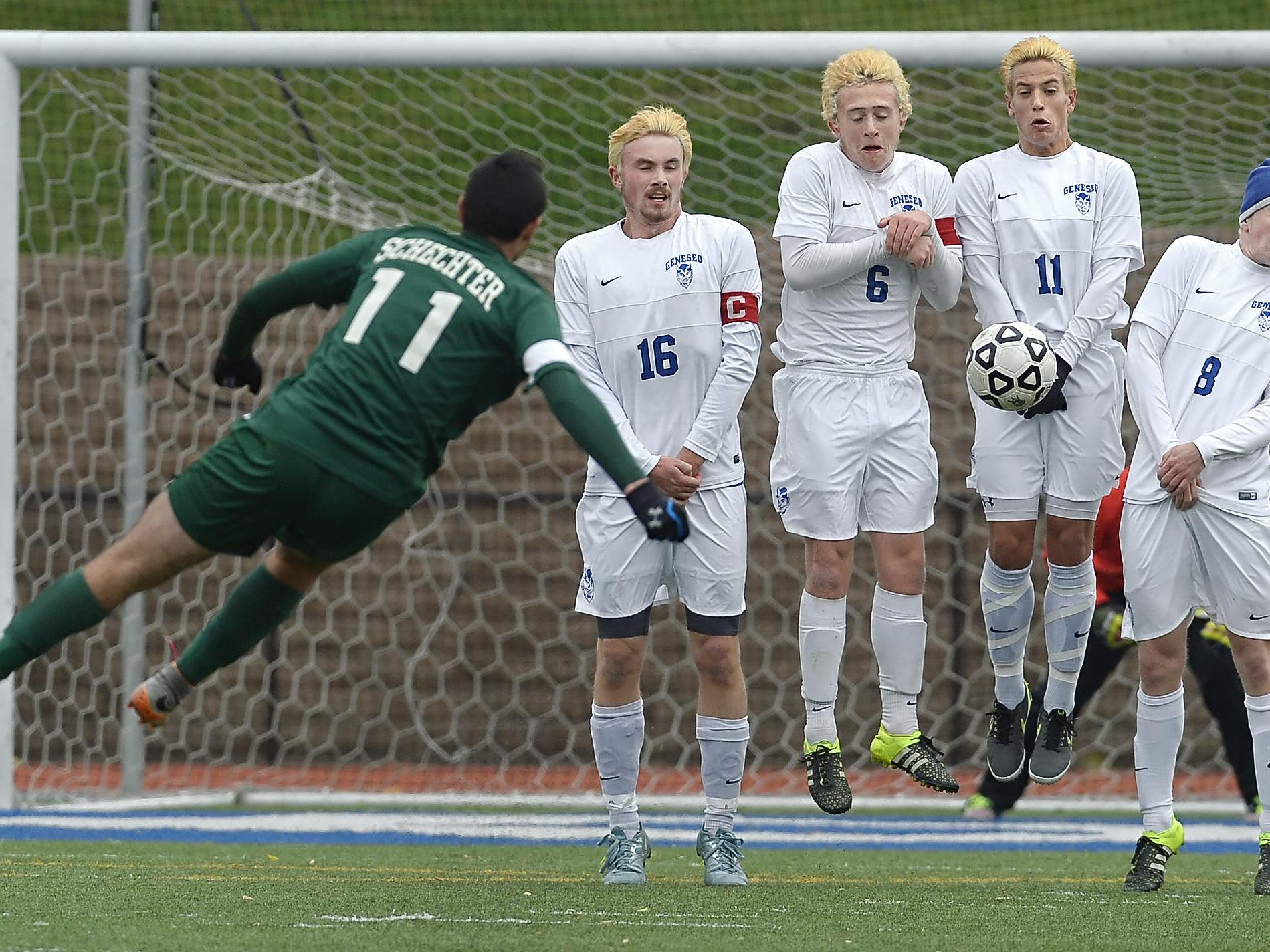 Geneseo's wall of Danny Cannon, right, Mike Caruso, Ethan Roth and Sean Kelly stop a free kick by Schecter's Jonathan Rand during a NYSPHSAA Boys Soccer Championships Class C semifinal played at Middletown High School on Saturday, November 14, 2015. Geneseo's season ends with a 1-0 loss to Schecter-I.