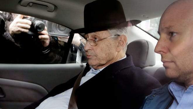New York Assembly Speaker Sheldon Silver, center, is driven by federal agents to federal court, Thursday, Jan. 22, 2015 in New York.