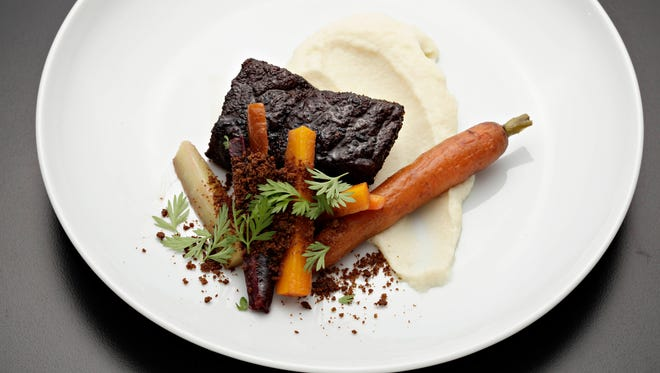 The asian spiced short rib over celery root puree with coffee roasted rainbow carrots from Top Home Chef candidate Alison Tedor in Phoenix, April, 2, 2015.
